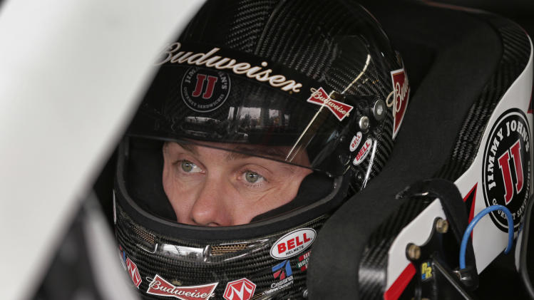 Kevin Harvick waits for practice for Saturday's NASCAR Sprint Cup Series auto race at Charlotte Motor Speedway in Concord, N.C., Thursday, Oct. 10, 2013. (AP Photo/Chuck Burton)