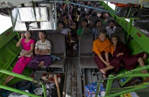 In this Sept. 11, 2013 photo, Buddhist monks and villagers…