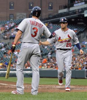 St. Louis Cardinals' Ryan Theriot, left, congratulates Colby Rasmus, who scored on a single by Nick Punto in the second inning of a baseball game against the Baltimore Orioles on Tuesday, June 28, 2011 in Baltimore.(AP Photo/Gail Burton)