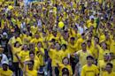 "Protesters shout slogans during a rally organised by pro-democracy group ""Bersih"" (Clean) near Dataran Merdeka in Malaysia's capital city of Kuala Lumpur"