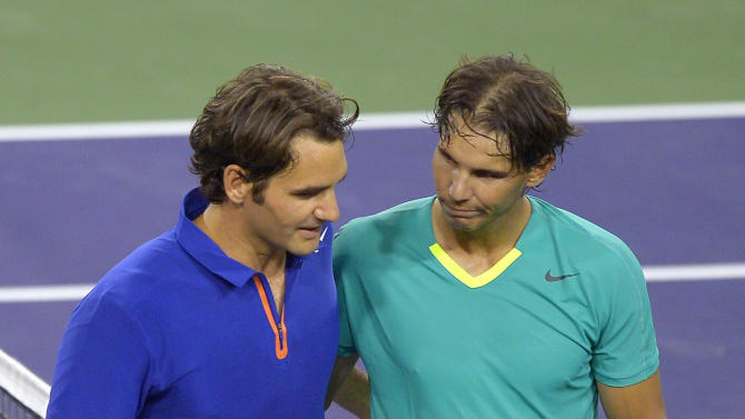 Rafael Nadal, right, of Spain, hugs Roger Federer, of Switzerland, after Nadal's win at the BNP Paribas Open tennis tournament, Thursday, March 14, 2013, in Indian Wells, Calif. Nadal won 6-4, 6-2. (AP Photo/Mark J. Terrill)
