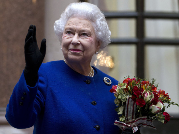 FILE - In this Tuesday, Dec. 18, 2012 file photo, Britain&#39;s Queen Elizabeth II looks up and waves to members of staff of The Foreign and Commonwealth Office as she ends an official visit which is part of her Jubilee celebrations in London. Queen Elizabeth has been taken to the King Edward VII hospital in central London suffering from gastroenteritis, Sunday, March 3, 2013. A palace spokesman said she was expected to stay in hospital for two days and all engagements for this week will be either postponed or cancelled.(AP Photo/Alastair Grant Pool, file)