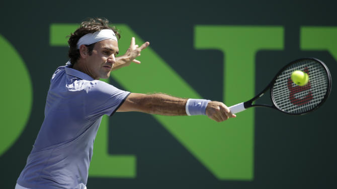 Federer edges 6-foot-11 Karlovic with big serve