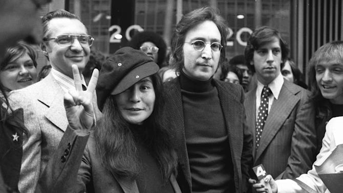 John Lennon and his wife, Yoko Ono, leave a U.S. Immigration hearing in New York City