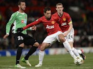 Manchester United's Mexican forward Javier Hernandez (C) holds off Cluj's Brazilian midfielder Luis Alberto. United manager Sir Alex Ferguson insists he has no worries about going into Sunday's Manchester derby on the back of a 1-0 defeat to Champions League minnows Cluj -- United's first home loss in the competition in more than three years
