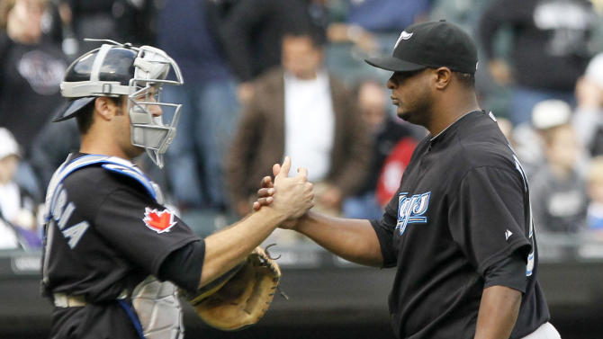 Toronto Blue Jays catcher J.P. Arencibia, left, celebrates with relief pitcher Frank Francisco after the Blue Jays' 3-2 win over the Chicago White Sox in a baseball game Wednesday, Sept. 28, 2011, in Chicago. (AP Photo/Charles Rex Arbogast)