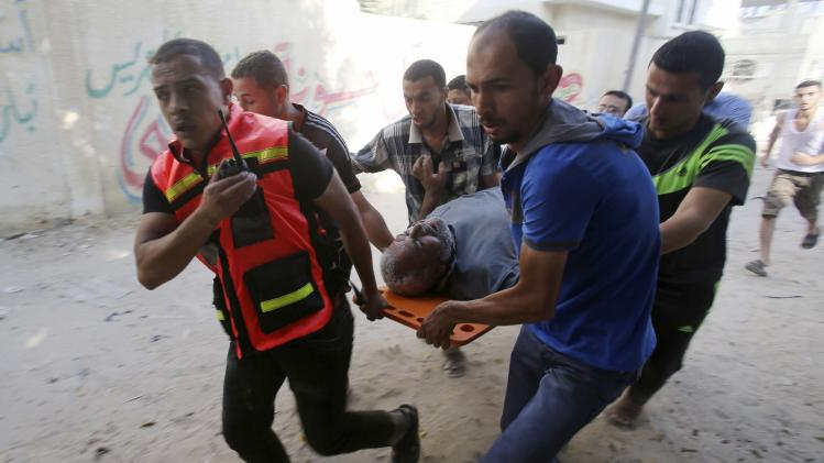 Palestinians evacuate a wounded man in Rafah in the southern Gaza Strip