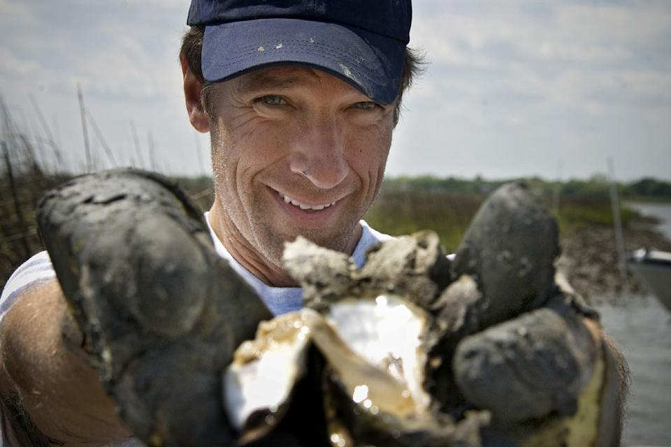 Dirty Jobs host Mike Rowe  experiences work at an oyster reef