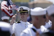 A sailor waves a flag during the gay pride parade Saturday, July 21, 2012, in San Diego. For the first time ever, U.S. service members marched in a gay&#160;pride event decked out in uniform Saturday, after a recent memorandum from the Defense Department to all military branches made an allowance for the San Diego parade - even though its policy generally bars troops from marching in uniform in parades. (AP Photo/Gregory Bull)