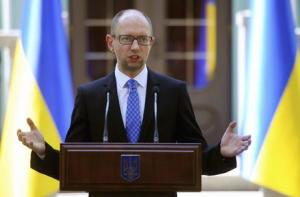 Ukraine's PM Yatseniuk speaks to the media in  …