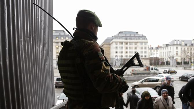 A Belgian soldier stands guard outside the Palace of Justice in Brussels