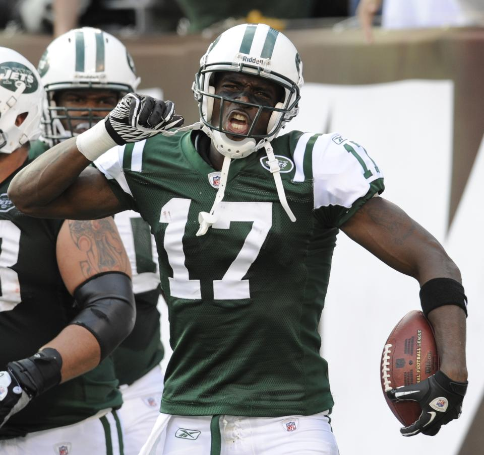New York Jets' Plaxico Burress celebrates this third touchdown during the fourth quarter of an NFL football game against the San Diego Chargers, Sunday, Oct. 23, 2011, in East Rutherford, N.J. The Jets defeated the Chargers 27-21. (AP Photo/Bill Kostroun)