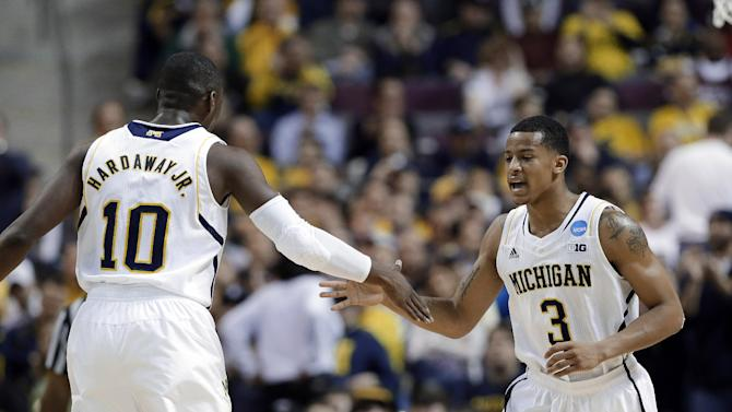 Michigan guards Tim Hardaway Jr. (10) and Trey Burke (3) celebrate in the second half against South Dakota State in a second-round game of the NCAA men's college basketball tournament in Auburn Hills, Mich., Thursday March 21, 2013. Michigan won 71-56. (AP Photo/Paul Sancya)