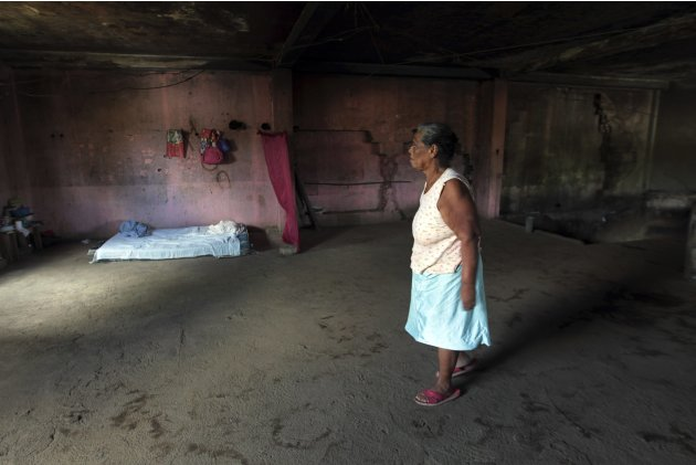 Alvarado walks inside her home, which is the ruins of a shoe store in California building that was damaged by the 1972 earthquake, in the old centre of Managua