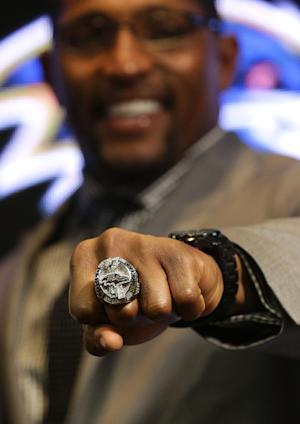 Former Baltimore Ravens linebacker Ray Lewis displays his Super Bowl XLVII championship ring after receiving it at a ceremony at the team's NFL football practice facility in Owings Mills, Md., Friday, June 7, 2013. The Ravens defeated the San Francisco 49ers 34-31 to win their second franchise Super Bowl. (AP Photo/Patrick Semansky)