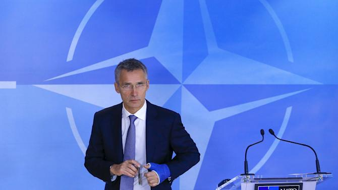 NATO Secretary-General Jens Stoltenberg leaves the room after holding a news conference at the start of a meeting of the NATO foreign affairs ministers at the Alliance headquarters in Brussels