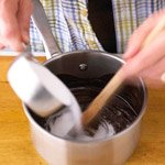 Stirring sugar into chocolate mixture