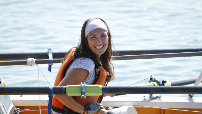 Jenn Gibbons smiles as she completes a 1,500 mile rowing trip around Lake Michigan to raise money for an organization helping cancer survivors on Tuesday, Aug. 14, 2012  in Chicago. The trip helped 27-year-old Gibbons raise $113,000 for Recovery on Water (ROW). (AP Photo/Sitthixay Ditthavong)