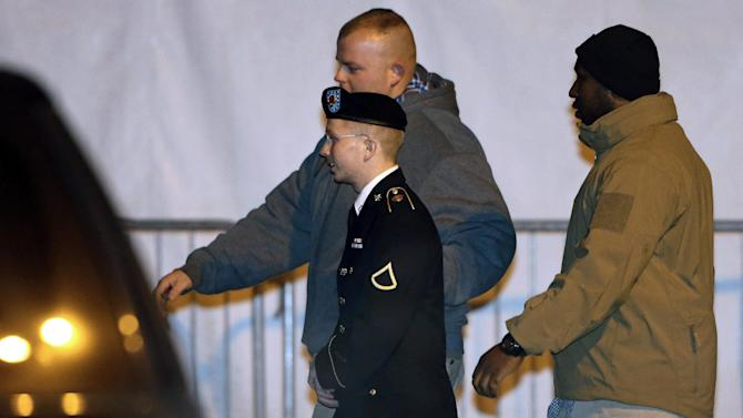 Army Pfc. Bradley Manning, center, is escorted to a security vehicle outside of a courthouse in Fort Meade, Md., Tuesday, Nov. 27, 2012, after attending a pretrial hearing. Manning is charged with aiding the enemy by causing hundreds of thousands of classified documents to be published on the secret-sharing website WikiLeaks. (AP Photo/Patrick Semansky)
