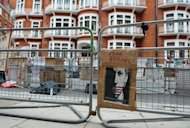 A poster is seen attached to a police barrier outside the Ecuadorian embassy in London, on August 15, where WikiLeaks founder Julian Assange is staying while awaiting a response from the Ecuadorian government on his asylum request. Assange sought refuge in the Ecuadoran embassy on June 19 and asked for asylum as he seeks to avoid extradition to Sweden