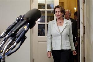 U.S. House Minority Leader Pelosi exits White House to speak to reporters after a meeting between House of Representatives Democrats and U.S. President Obama in Washington