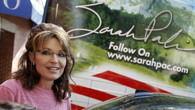 """FILE - In this June 2, 2011 file photo, former Alaska Gov. Sarah Palin stands near her tour bus outside a hotel in Boston. The Republican primary campaign is already fading into memory. Remember Herman Cain's 9-9-9 tax plan? Newt Gingrich's """"moon base"""" proposal? Or Rick Perry's """"oops"""" moment _ when he couldn't recall that third federal agency he wanted to eliminate? (AP Photo/Steven Senne, File)"""