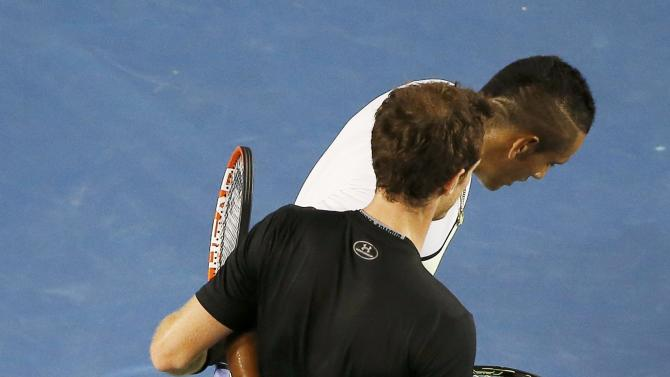 Andy Murray (L) of Britain embraces Nick Kyrgios of Australia after defeating him in their men's singles quarter-final match at the Australian Open 2015 tennis tournament in Melbourne