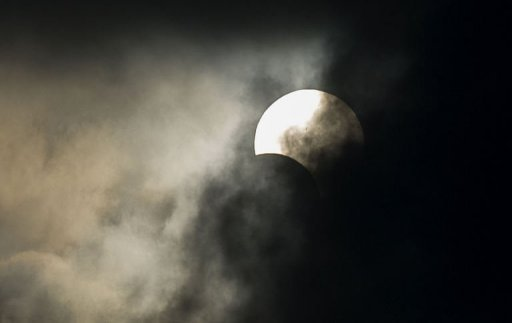"""Some early risers in Hong Kong were able to see only a small sliver of the """"annular"""" eclipse"""