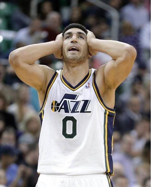 Utah Jazz's Enes Kanter holds his head as he reacts to a call in the second half during an NBA preseason basketball game against the Portland Trail Blazers on Wednesday, Oct. 16, 2013, in Salt Lake Ci
