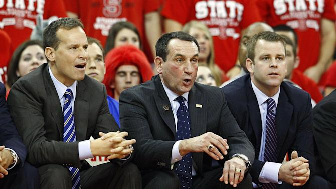 Duke head coach Mike Krzyzweski watches from the bench with assistant coaches Chris Collins, left, and Steve Wojciechowski, right during the second half of an NCAA college basketball game against North Carolina State in Raleigh, N.C., Saturday, Jan. 12, 2013. Duke lost 84-76. (AP Photo/Karl B DeBlaker)