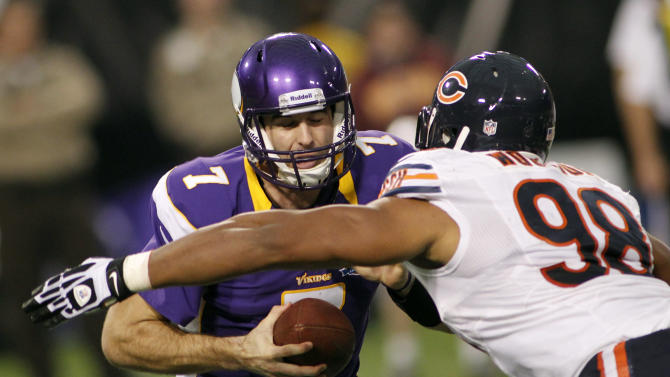 Minnesota Vikings quarterback Christian Ponder, left, is sacked by Chicago Bears defensive end Corey Wootton during the first half of an NFL football game Sunday, Dec. 9, 2012, in Minneapolis. (AP Photo/Andy King)
