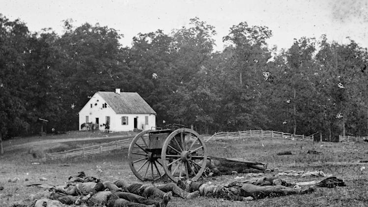 "This 1862 photograph made available by the Library of Congress shows casualties from the Battle of Antietam near the church of the pacifist Dunker sect near Sharpsburg, Md. When dawn broke along Antietam Creek on Sept. 17, 1862, cannon volleys launched a Civil War battle that would leave 23,000 casualties on the single bloodiest day in U.S. history and mark a crucial pivot point in the war. And yet it might never have occurred - if not for what a historian calls a ""freakish"" twist of fate. Days earlier, a copy of Gen. Robert E. Lee's detailed invasion orders, wrapped around a few cigars, accidentally fell in a farm field and were discovered by Union infantrymen who passed their stunning find up the chain of command, spurring action. (AP Photo/Library of Congress)"