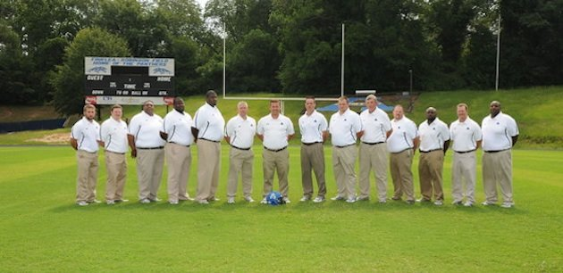 The Americus-Sumter coaching staff, with Michael Pollock at center — Americus-Sumter football