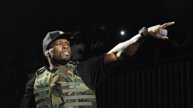 """FILE - This March 19, 2012 file image released by Fuse shows rapper 50 Cent, also known as Curtis Jackson, performing during the Fuse Live: Shady 2.0 SXSW concert at the Austin Music Hall in Austin, Texas.  50 Cent is out of the hospital after he was injured in a car accident in New York on Tuesday, June 26. A spokesperson for the 36-year-old says the rapper was taken to New York Hospital Queens and treated for """"minor neck and back injuries."""" (AP Photo/Fuse, Brandon Wade)"""