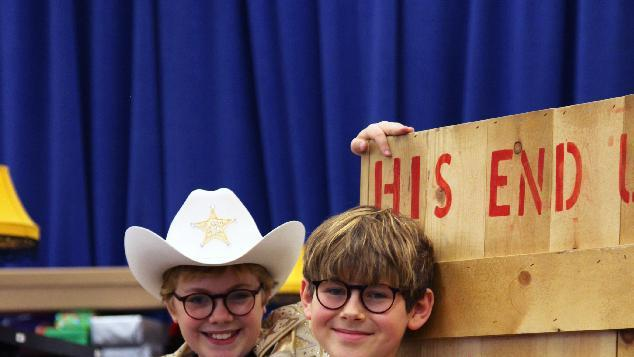 """In this Oct. 26, 2012, photo, Joe West, left, and Johnny Rabe pose in front of one of the props from """"A Christmas Story, the Musical"""" in New York. Both 12-year-old boys are making their Broadway debuts playing Ralphie in the stage adaptation of the cult 1983 film. (AP Photo/Mark Kennedy)"""