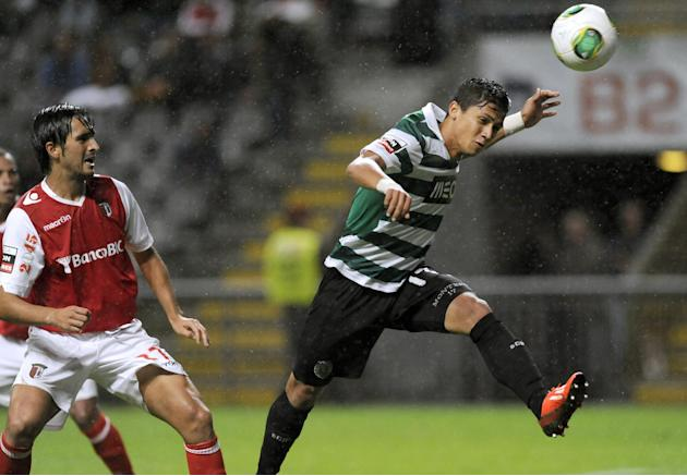 Sporting's Fredy Montero, from Colombia, heads for the ball past Sporting Braga's Custodio Castro, left, during their Portuguese League soccer match at the Municipal Stadium, in Braga, Portugal, Satur