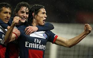 Paris Saint Germain's Edinson Cavani celebrates with his team mates after he scored against FC Lorient during their French Ligue 1 soccer match at the Parc des Princes Stadium in Paris