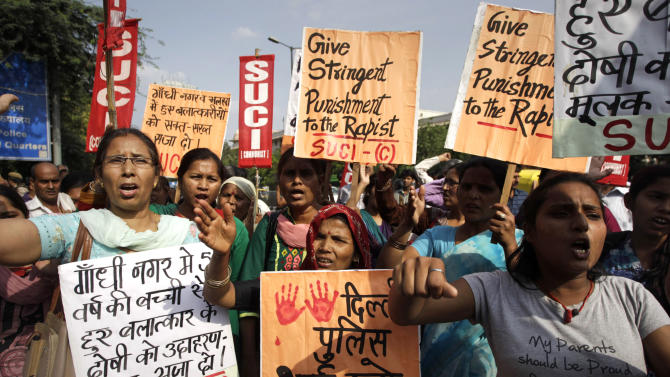 Protestors shout slogans as they hold placards demanding stringent punishment to rapists during a protest in New Delhi, India, Monday, April, 22, 2013. A second suspect was arrested Monday in the rape of a 5-year-old girl who New Delhi police said was left for dead in a locked room, a case that has brought a new wave of protests against how Indian authorities handle sex crimes. (AP Photo/Tsering Topgyal)