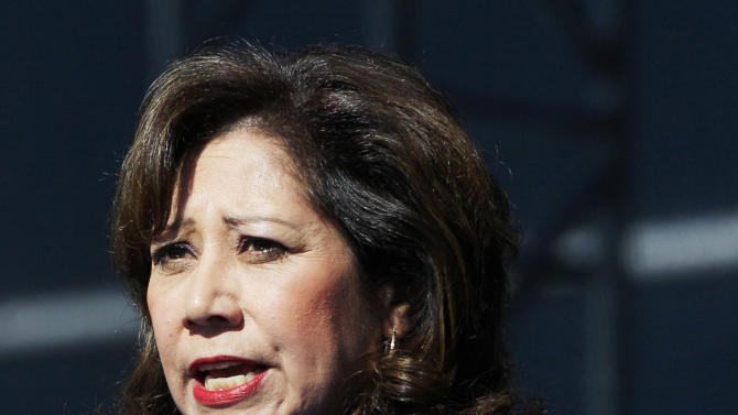 FILE - This Sept. 10, 2012 file photo shows Labor Secretary Hilda Solis addresses employees outside the Flat Rock Assembly in Flat Rock, Mich. Solis told colleagues she is resigning from Obama administration.  (AP Photo/Carlos Osorio, File)