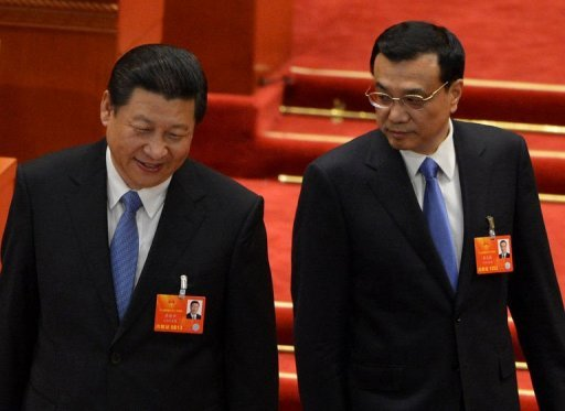 <p>Newly-elected Chinese President Xi Jinping (left) and Premier Li Keqiang arrive to vote during the election of the new vice premiers, foreign and defense ministers during the 12th National People's Congress (NPC) at the Great Hall of the People in Beijing, on March 16, 2013.</p>