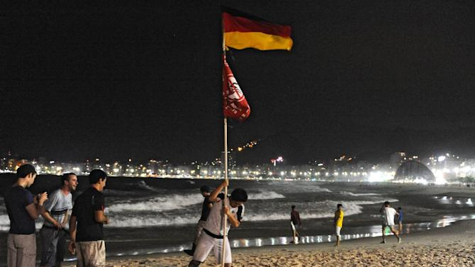 Fans of Germany celebrate after finishing the FIFA World Cup final between Germany and Argentina at the Fan Fest at Copacabana beach in Rio de Janeiro, Brazil, on July 13, 2014