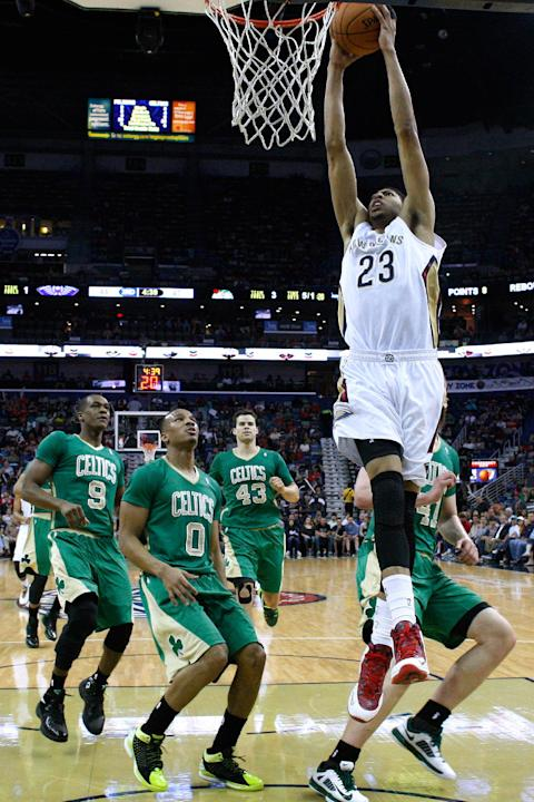 New Orleans Pelicans forward Anthony Davis (23) shoots past Boston Celtics guard Rajon Rondo (9), guard Avery Bradley (0), center Kris Humphries (43) and center Kelly Olynyk, right, during the first h
