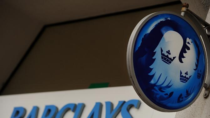 Shares in Barclays closed down 3.22 percent to 254.30 pence after the embattled British bank said it had fallen into a net loss last year, hit by huge costs linked to its alleged role in the rigging of foreign exchange markets