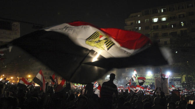 "Egyptians celebrate the victory of Mohammed Morsi in Cairo's Tahrir Square Monday, June 25, 2012. The Muslim Brotherhood's Mohammed Morsi was declared the winner of Egypt's first free presidential election Sunday, and he proclaimed himself a leader ""for all Egyptians,"" although he faces a struggle for power with the country's still-dominant military rulers. (AP Photo/Thomas Hartwell)"