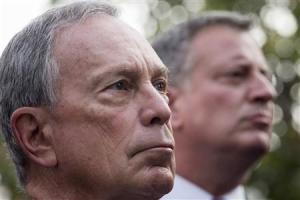 New York Mayor Michael Bloomberg is seen standing near mayoral candidate Bill de Blasio during the 9/11 Memorial ceremonies marking the 12th anniversary of the 9/11 attacks on the World Trade Center in New York