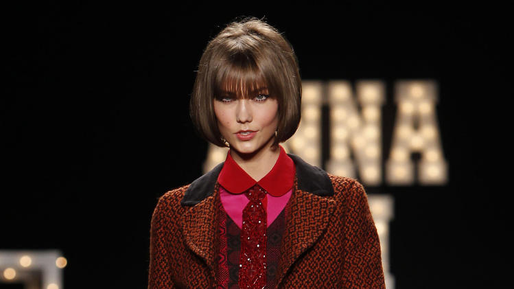 Karlie Kloss models an outfit from the Anna Sui Fall 2013 collection during Fashion Week, Wednesday, Feb. 13, 2013 in New York. (AP Photo/Jason DeCrow)
