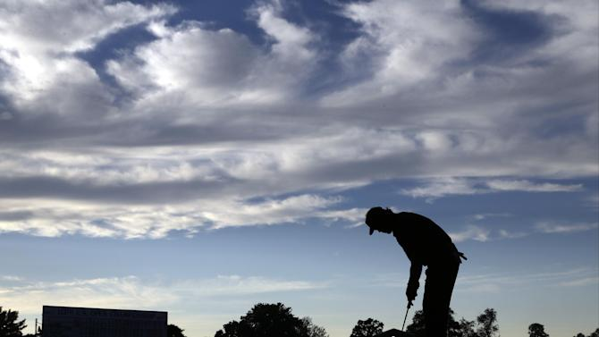 Phil Mickelson putts on the 18th hole during the fourth round of the U.S. Open golf tournament at Merion Golf Club, Sunday, June 16, 2013, in Ardmore, Pa. (AP Photo/Morry Gash)