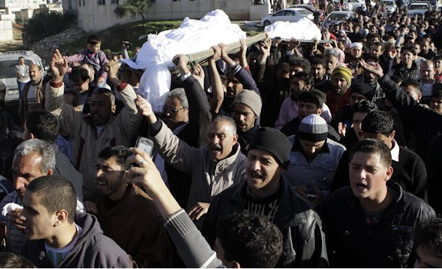 Syrians and Jordanians mourn 7 members of one Syrian family who died late last Wednesday night after a fire start in their caravan at King Abdullah Gardens refugees processing center, in Ramtha, near 