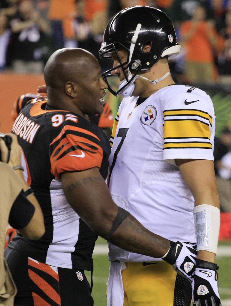 Cincinnati Bengals outside linebacker James Harrison (92) hugs Pittsburgh Steelers quarterback Ben Roethlisberger (7) after the Bengals defeated the Steelers 20-10 in an NFL football game, Monday, Sept. 16, 2013, in Cincinnati. (AP Photo/Tom Uhlman)