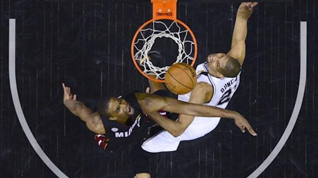 Miami Heat Chris Bosh (L) stops San Antonio Spurs Tim Duncan from scoring during Game 4 of their NBA Finals basketball series in San Antonio (Reuters)